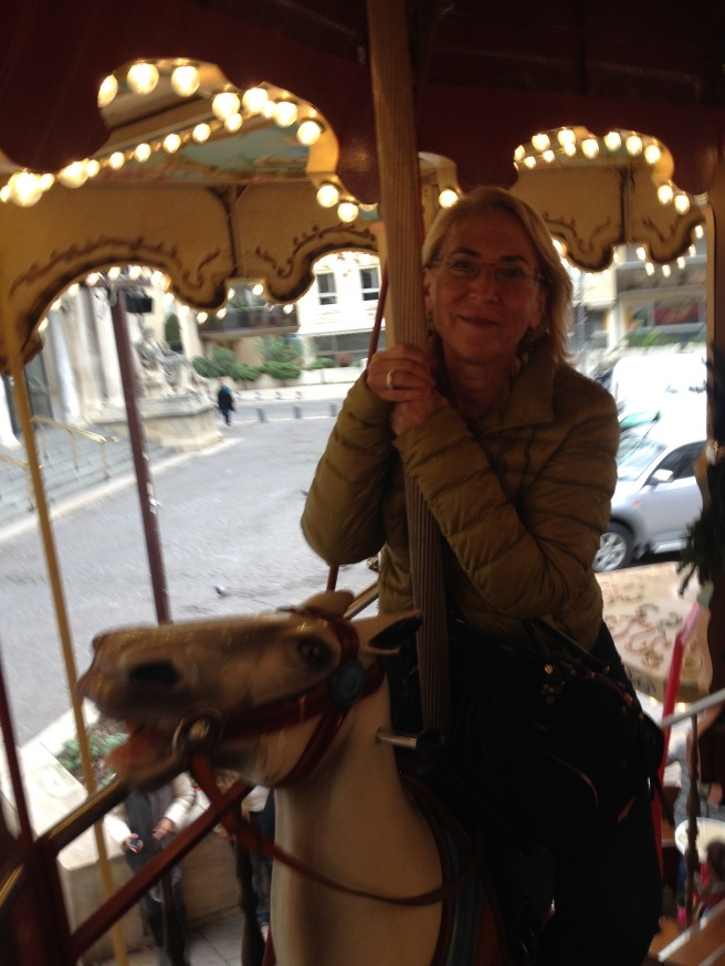 Sue Guiney on a merry-go-round